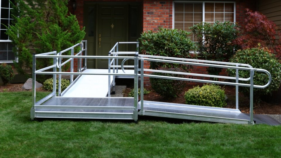 Photo of a semi-permanent or modular ramp for a wheelchair.